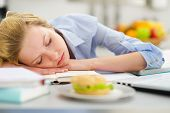 Teenage Girl Fall Asleep While Studying In Kitchen