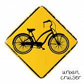 warning road sign with a urban cruiser bike