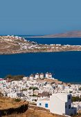 Chora Mykonos With Windmills On The Background Of The Sea And Islands