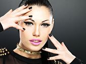 Beautiful Face Of Fashion Woman With Black Nails And Bright Makeup.
