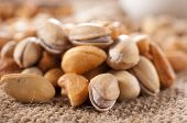 stock photo of ladle  - Nuts mix with pistachio and cashew nuts - JPG