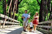 Family Walking Across Bridge