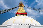 Buddhist shrine Boudhanath Stupa with Buddha wisdom eyes and praying flags in Kathmandu, Nepal