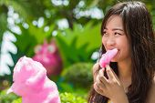 Cute Thai Girl Is Eating Pink Candyfloss