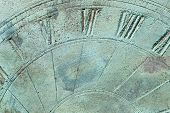 Abstract background showing textured surface of sun dial.