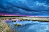 Storm Over Swamp At Sunset