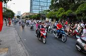 Haotic traffic in Saigon, thousands of motorbikes