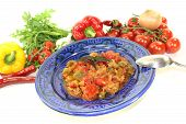 stock photo of tagine  - Moroccan Tagine Kefta with tomatoes peppers and ground beef on a bright background - JPG