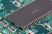 stock photo of pnp  - closeup of a microchip on a circuit board - JPG