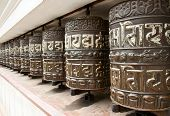 stock photo of sanskrit  - Ancient Prayer wheels in Swayambhunath - JPG