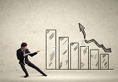 image of revenue  - Image of young businessman pulling graph - JPG