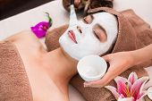 stock photo of female mask  - Young woman having peeling in spa salon - JPG