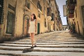 mediterranean woman walking in the city of Valletta in Malta
