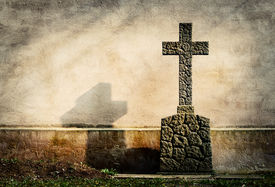 stock photo of empty tomb  - cross on tombstone grunge wall background - JPG