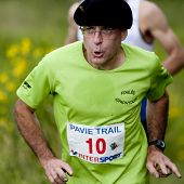 Male runner wearing a beret.
