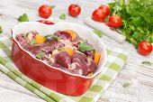 stock photo of giblets  - Raw chicken liver in heart shaped bowl - JPG