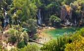 KRAVICE WATERFALLS, BOSNIA AND HERZEGOVINA - AUG 10, 2012: Tourists swimming in river at Kravice Wat