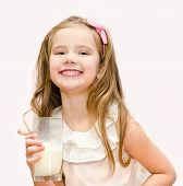 Happy Cute Little Girl With Glass Of Milk