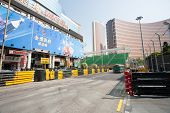 MACAU, CHINA - NOVEMBER 2, 2012: Safety barriers installed along streets before the upcoming racing Macau Grand Prix in stages Formula 3, FIA WTCC, motorcycle prize. Race takes place on the streets.