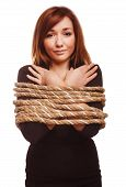 stock photo of slavery  - woman prisoner tied rope hostage female bondage bound girl slavery isolated hands - JPG