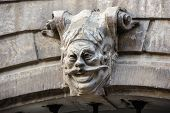 image of gargoyles  - Scary gargoyle on the gateway in Lviv - JPG