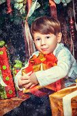 Portrait of adorable boy with  New Year's gifts