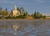 stock photo of larnaca  - Hala Sultan Tekke or Mosque of Umm Haram is a Muslim shrine on the west bank of Larnaca Salt Lake in Cyprus.