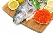 Trout, Red Caviar, Lemon And Vegetables On A Cutting Board Close Up