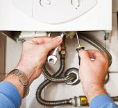 stock photo of boiler  - a Plumber at work - JPG