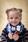 picture of cough syrup  - Little girl portrait with medical cough syrup in a bottle - JPG