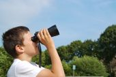 Kid Is Looking Through Binoculars