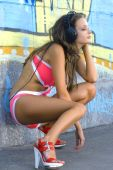 Girl In Bathing Suit Is Listening Music