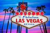 stock photo of nightfall  - Welcome to Fabulous Las Vegas sign sunset with palm trees Nevada photo mount   - JPG