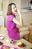 Happy Woman Eating Strawberry For Breakfast