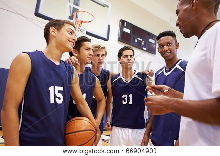 Male High School Basketball Team Having Team Talk With Coach poster