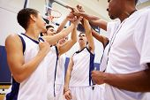 image of motivation talk  - Male High School Basketball Team Having Team Talk With Coach - JPG