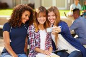 Female High School Students Taking Selfie On Campus