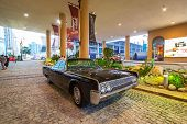 DUBAI, UAE - MARCH 30, 2014: 1961 Lincoln Continental parked outside the hotel in Dubai on 30 March