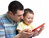 Child And Dad Play And Read Tablet Computer