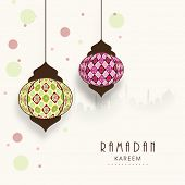 Stylish hanging arabic lanterns on mosque silhouetted colorful abstract background for holy month of