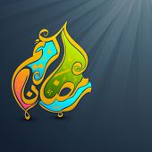 Arabic Islamic calligraphy of colorful text Ramadan Kareem on shiny grey background for holy month o