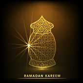 Golden floral decorated traditional lantern on shiny brown background for holy month of Ramadan Kare