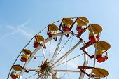 People Riding Giant Ferris Wheel