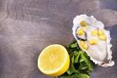 pic of oyster shell  - Tasty cooked oyster in shell on wooden table - JPG