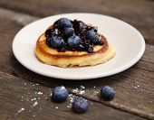 Delicious pancakes with blueberry jam
