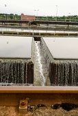 stock photo of wastewater  - Primary radial settler at wastewater sewage water treatment plant - JPG