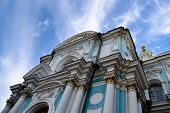 Постер, плакат: Christian Church with a cross on blue sky background