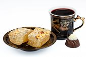 Eastern sweets with coffee and candy on a white background
