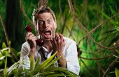 image of scream  - Angry businessman lost in jungle screaming at the phone - JPG