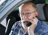 Angry Old Man Yelling On Cell Phone In Car